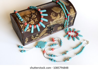 Turquoise and red croal necklaces with antique gift box isolated on white