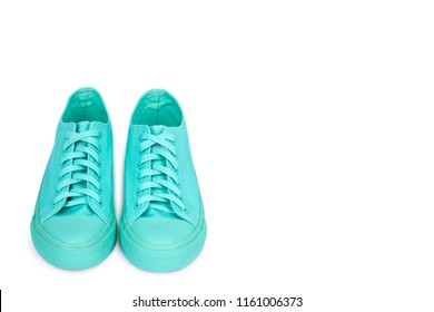 Turquoise rubber sneakers, casual footwear isolated on white background, copy space template.
