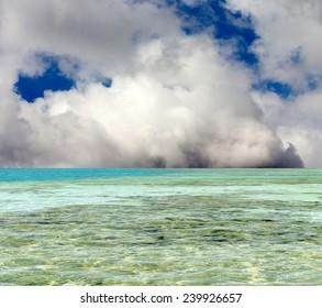 turquoise sea against the sky with clouds