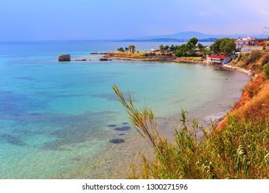 turquoise sea bay and old port of Nea Potidea or Nea Poteidea in peninsula Kassandra, Chalkidiki, Greece