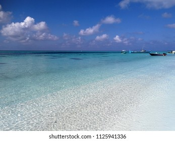 Turquoise sea, white sand and blue sky