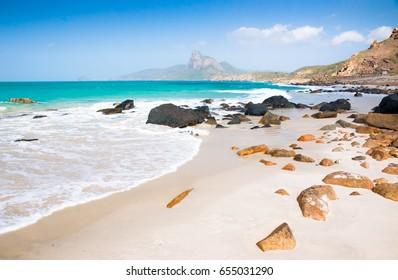 turquoise sea white sand and rocky under sunshine very beautiful nature at Bai nhat beach Condao island - Vietnam.