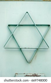 turquoise star of david made of metal and attached to a door