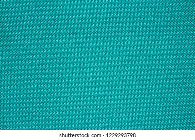 Turquoise texture of binding fabric.Green fabric background.Turquoise fabric. Background with textured surface.