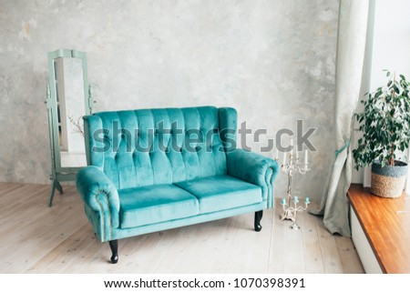 Turquoise Velvet Sofa Stands In A Bright Classic Room Opposite The Window  With Plant