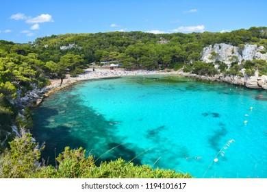 Turquoise water in bay Cala Macarella on Menorca island in Spain