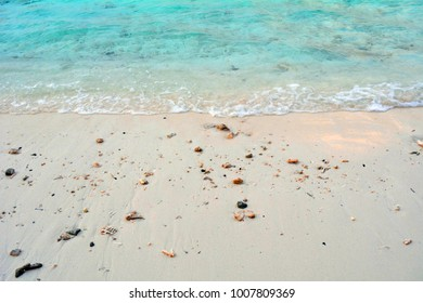 Turquoise water at the beach with light sand