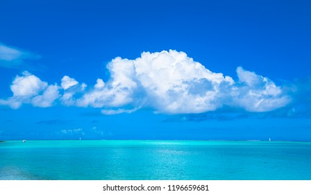 Turquoise water, blue sky and white clouds