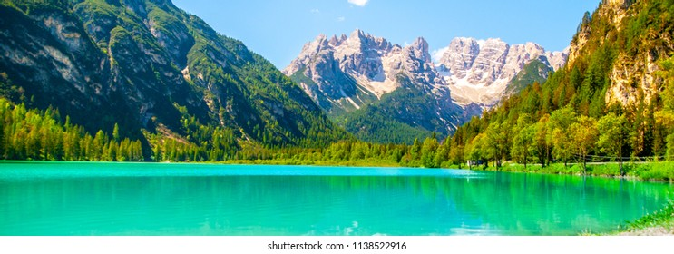 Turquoise water of Lago di Landro, Durrensee, and beautiful mountains of Dolomites, Italy.