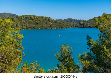 Turquoise water of Malo Jezero at Mljet national park in Croatia - Shutterstock ID 2008034846