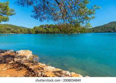 Turquoise water of Malo Jezero at Mljet national park in Croatia - Shutterstock ID 2008034849