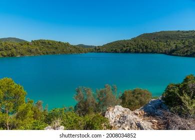 Turquoise water of Malo Jezero at Mljet national park in Croatia - Shutterstock ID 2008034852