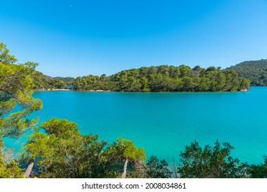 Turquoise water of Malo Jezero at Mljet national park in Croatia - Shutterstock ID 2008034861