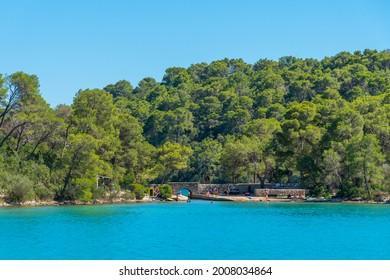 Turquoise water of Malo Jezero at Mljet national park in Croatia - Shutterstock ID 2008034864