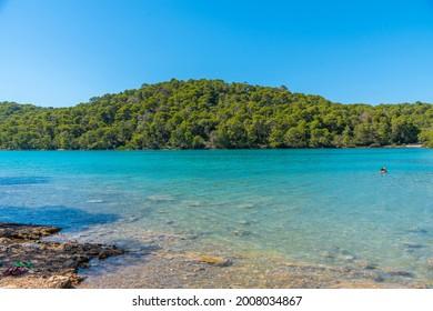 Turquoise water of Malo Jezero at Mljet national park in Croatia - Shutterstock ID 2008034867