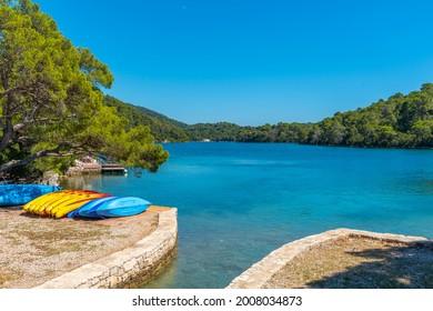 Turquoise water of Malo Jezero at Mljet national park in Croatia - Shutterstock ID 2008034873