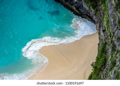 Turquoise water meets the sand on a beautiful deserted tropical beach