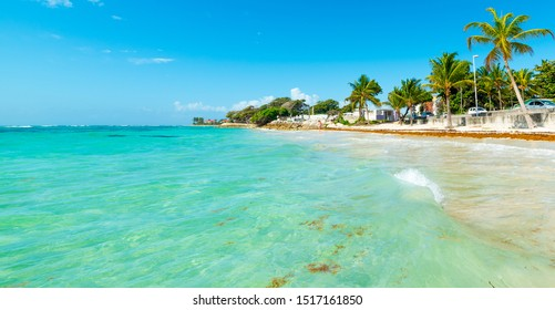 Turquoise water in Raisins Clairs beach in Guadeloupe, French west indies. Lesser Antilles, Caribbean sea