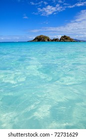 turquoise water of trunk bay, us virgin islands, focus on water in foreground