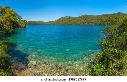 Turquoise water of Veliko Jezero at Mljet national park in Croatia - Shutterstock ID 1989317999
