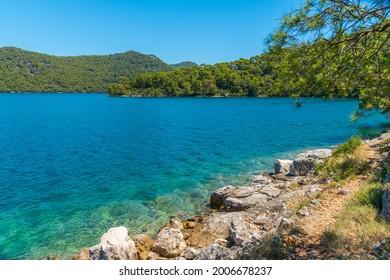 Turquoise water of Veliko Jezero at Mljet national park in Croatia - Shutterstock ID 2006678237