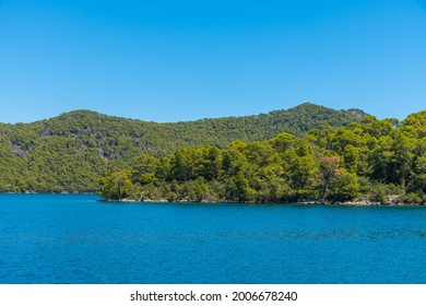 Turquoise water of Veliko Jezero at Mljet national park in Croatia - Shutterstock ID 2006678240