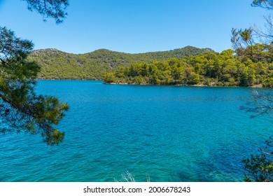 Turquoise water of Veliko Jezero at Mljet national park in Croatia - Shutterstock ID 2006678243
