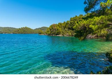 Turquoise water of Veliko Jezero at Mljet national park in Croatia - Shutterstock ID 2006678249