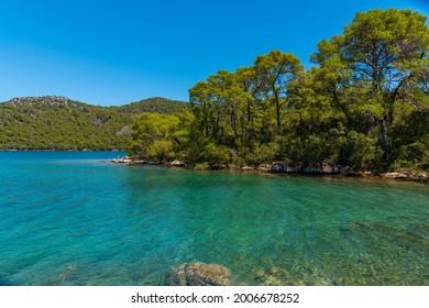 Turquoise water of Veliko Jezero at Mljet national park in Croatia - Shutterstock ID 2006678252