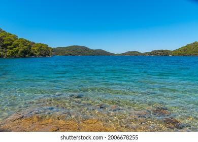 Turquoise water of Veliko Jezero at Mljet national park in Croatia - Shutterstock ID 2006678255