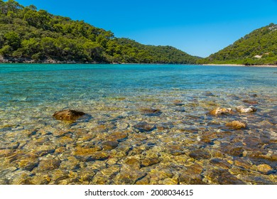 Turquoise water of Veliko Jezero at Mljet national park in Croatia - Shutterstock ID 2008034615