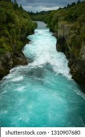Turquoise water of the Waikato River at Huka Falls waterfall, North Island, New Zealand