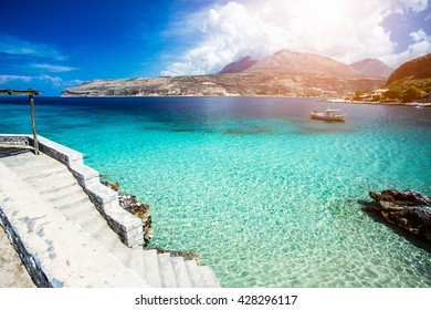 Turquoise waters of mediterranean sea with cliffs. Limeni, Greece.