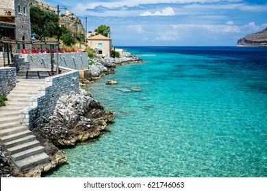 Turquoise waters of mediterranean sea with cliffs. Peloponnese, Limeni, Greece.