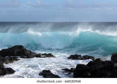 turquoise waves hitting the shoreline