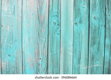 Turquoise wooden background with board. Great for design