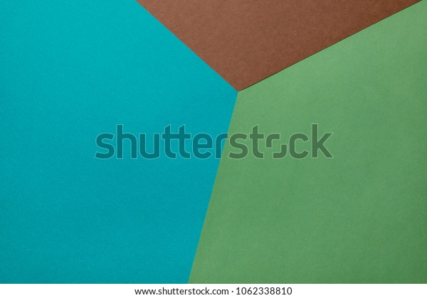 turquoise,green and brown colored paper background.
