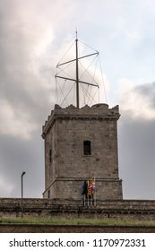 Turret of Montjuic Castle against cloudy sky. Montjuic Castle is an old military fortress, built on top of Montjuic hill. Now it serves as a municipal facility.