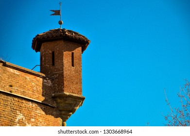 """A turret on the corner of the """"citadel"""", a 16th century fortress known mostly for its relevance in the siege of Turin, Italy in 1706. The turret is topped by a weathervane"""