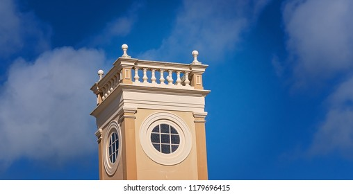 The turret of a town hall building in a small Australian town, isolated against the blue sky