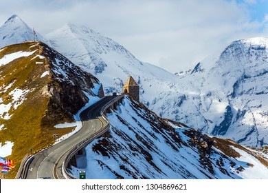 Turret at the turn of the road. Grand Austrian Alps. Alpine panoramic mountain road Grossglocknerstrasse. Snow melts. The concept of active, ecological and photo tourism