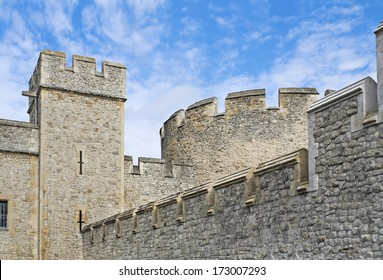 Turrets of famous London Tower on the blue sky background