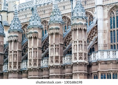 Turrets with flags decorate the House of Parliament in London, UK.