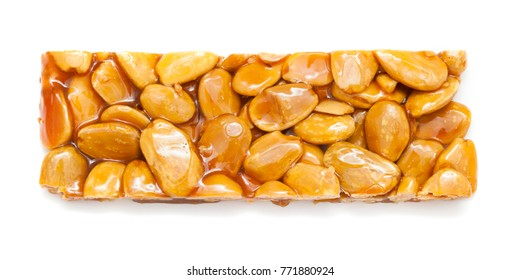 turron  bar of caramelised sugar and almonds isolated on white background