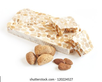 Turron, traditional Spanish almond dessert on a white plate.