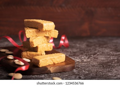 Turron is a typical Christmas food in Spain, usually prepared with almond nougat and fruits. Dark background