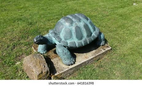 turtle statue on grass