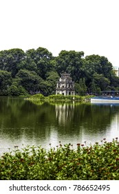 Turtle Tower with Green Trees behind It in the Center of Hoan Kiem Lake in Hanoi, Vietnam