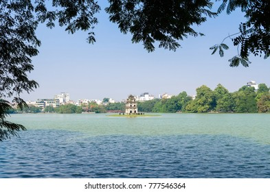 """Turtle Tower or Tortoise tower which is located in the middle of the Hoan Kiem Lake. Hoan Kiem Lake meaning """"Lake of the Returned Sword""""."""