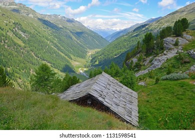 The Turtmann Valley in the Valais Region of Southern Switzerland with a traditional mountain hut in the foreground